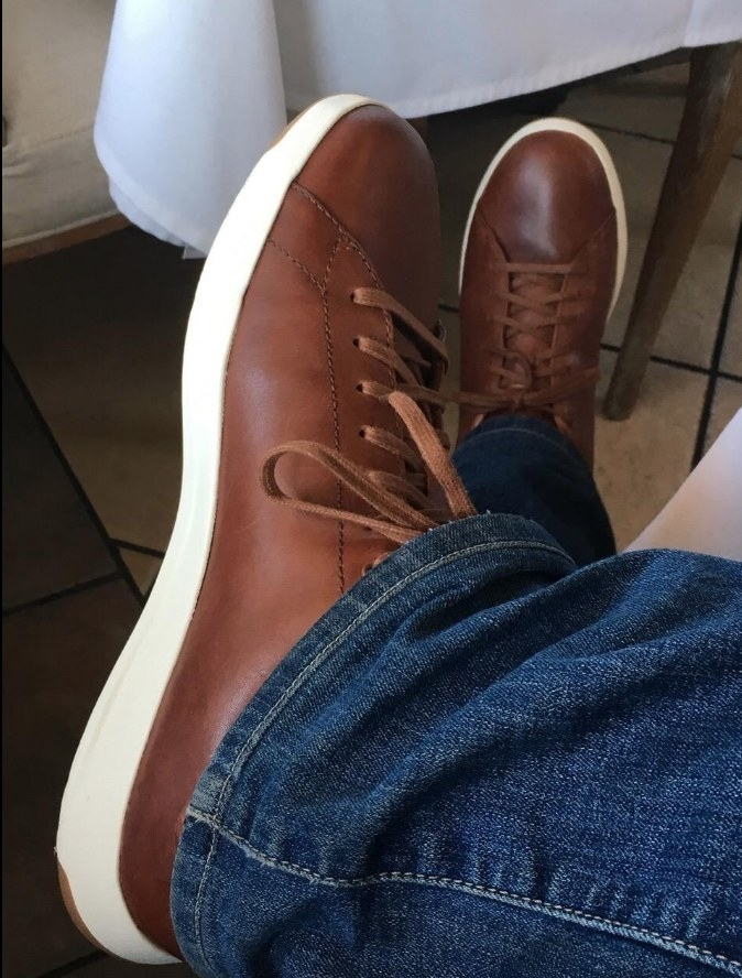 Brown leather sneaker paired with jeans