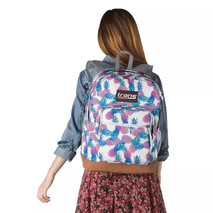 The white JanSport backpack with pink and blue pineapples