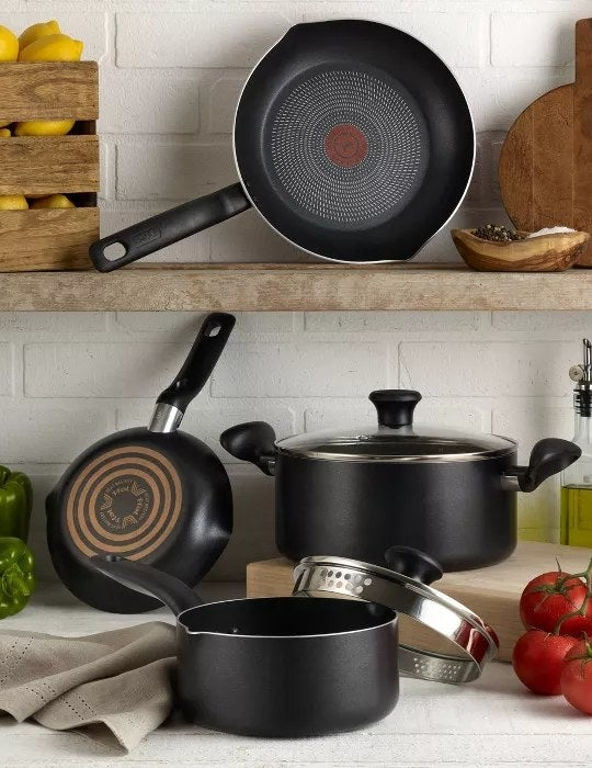 The black pots and pan with glass lids
