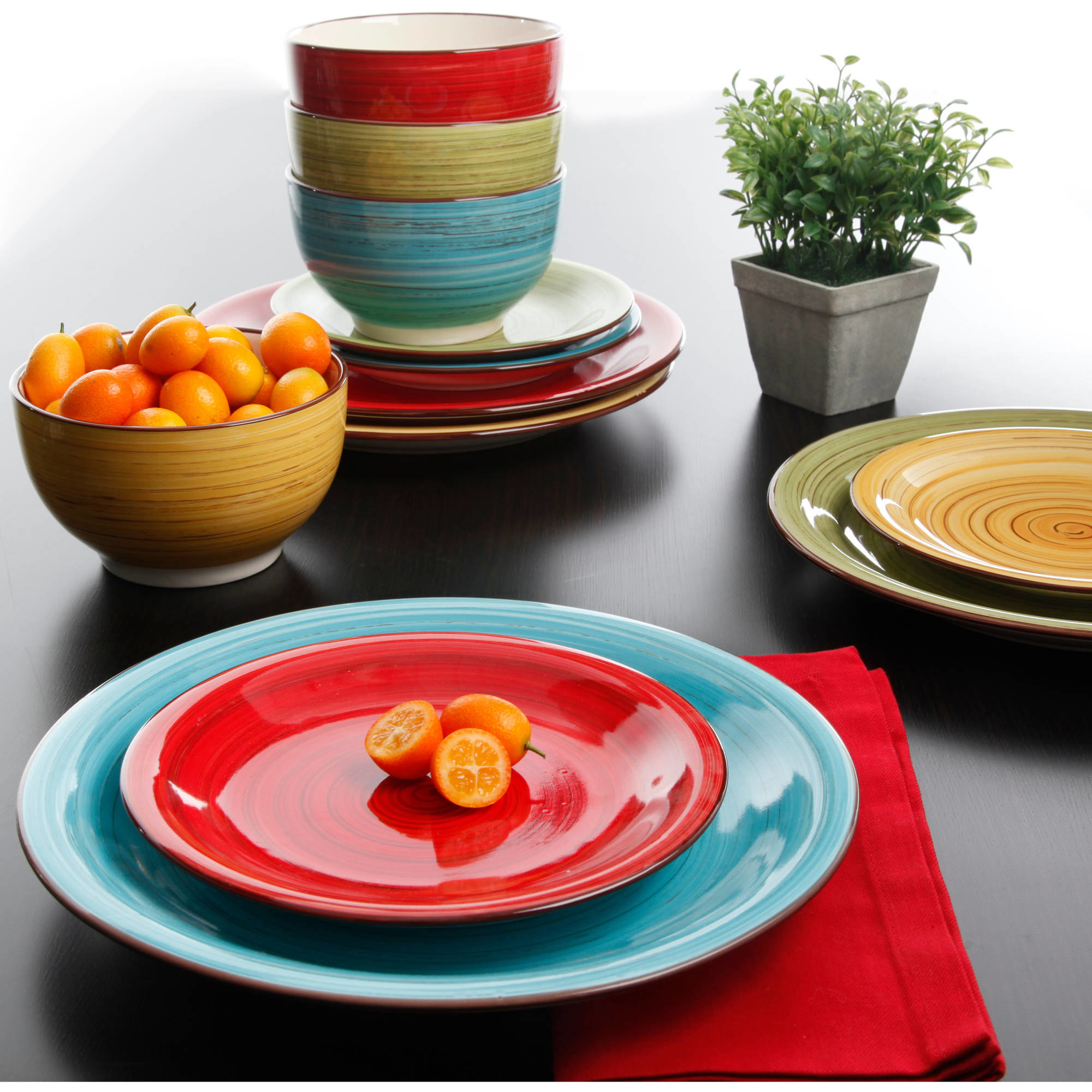 Thehand-painted festival dinnerware set of twelve