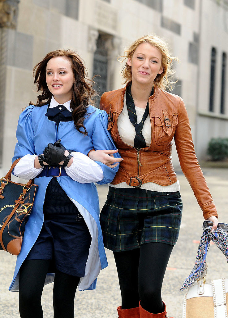 Leighton Meester and Blake Lively, with her arm through Leighton's arm, on location during filming of ''Gossip Girl''