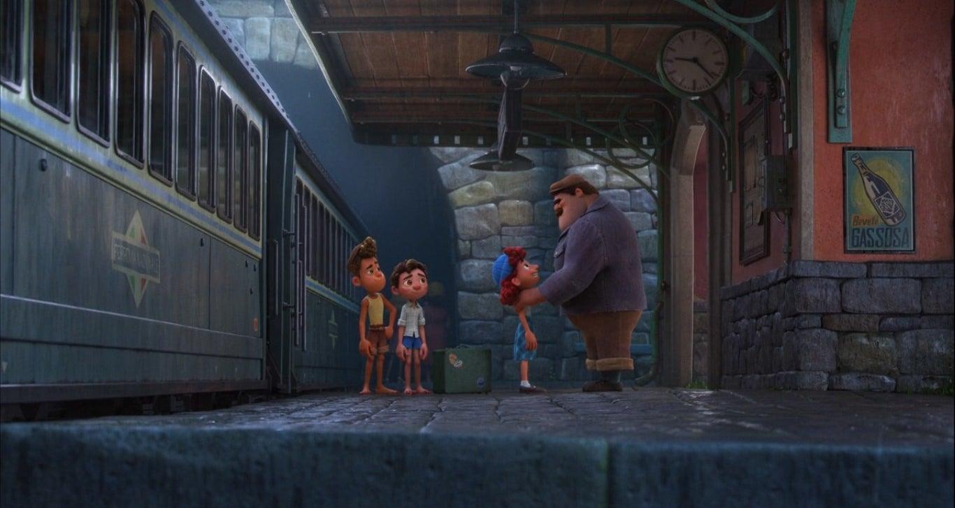 Alberto, Luca, Giulia, and Massimo at the train station