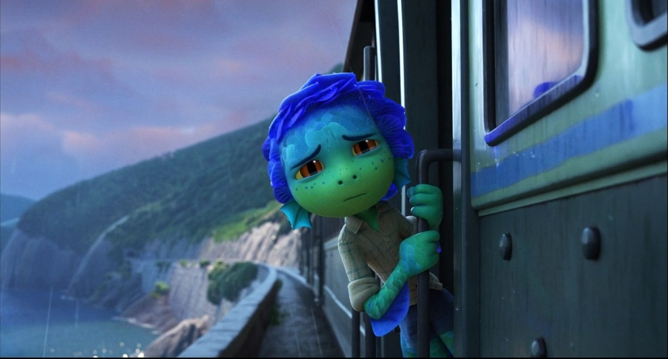 Sea monster Luca hanging out of a train