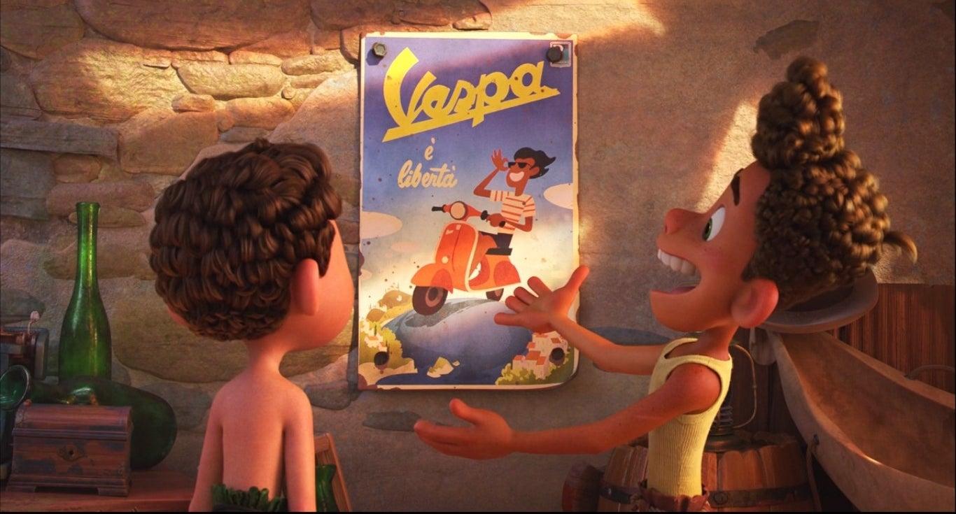 Alberto shows Luca a poster of a Vespa