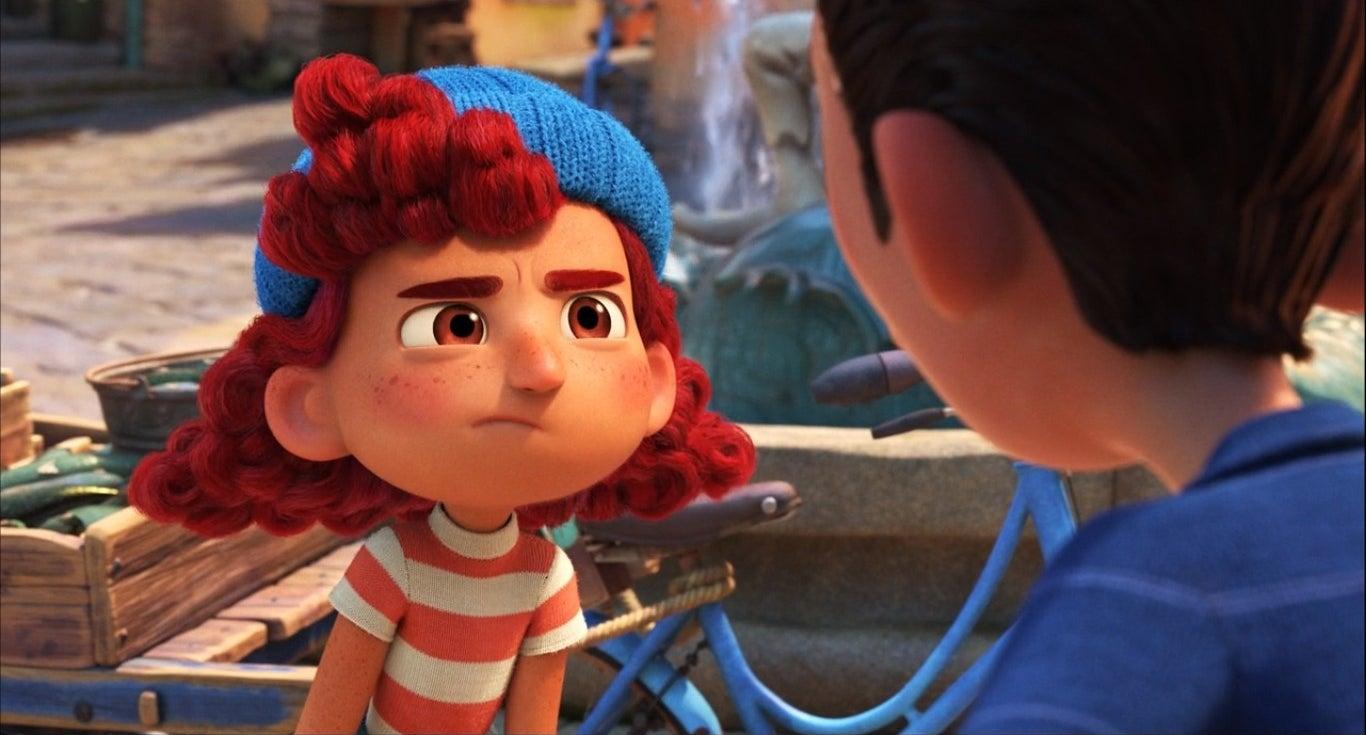 Giulia wearing a blue knit hat