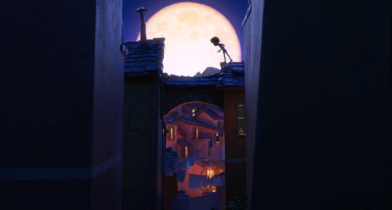 Luca runs across rooves at night