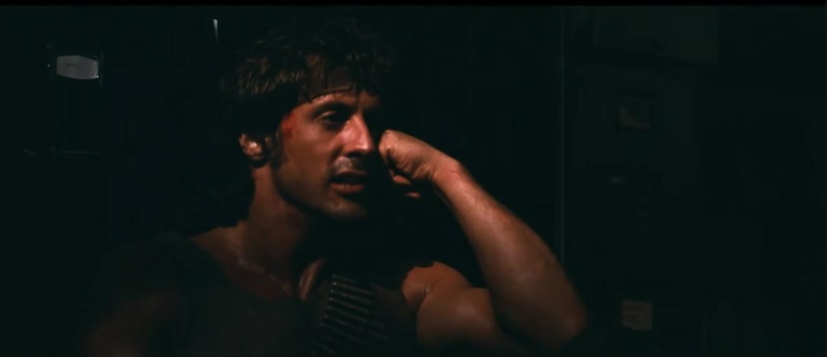 Rambo sitting in the dark