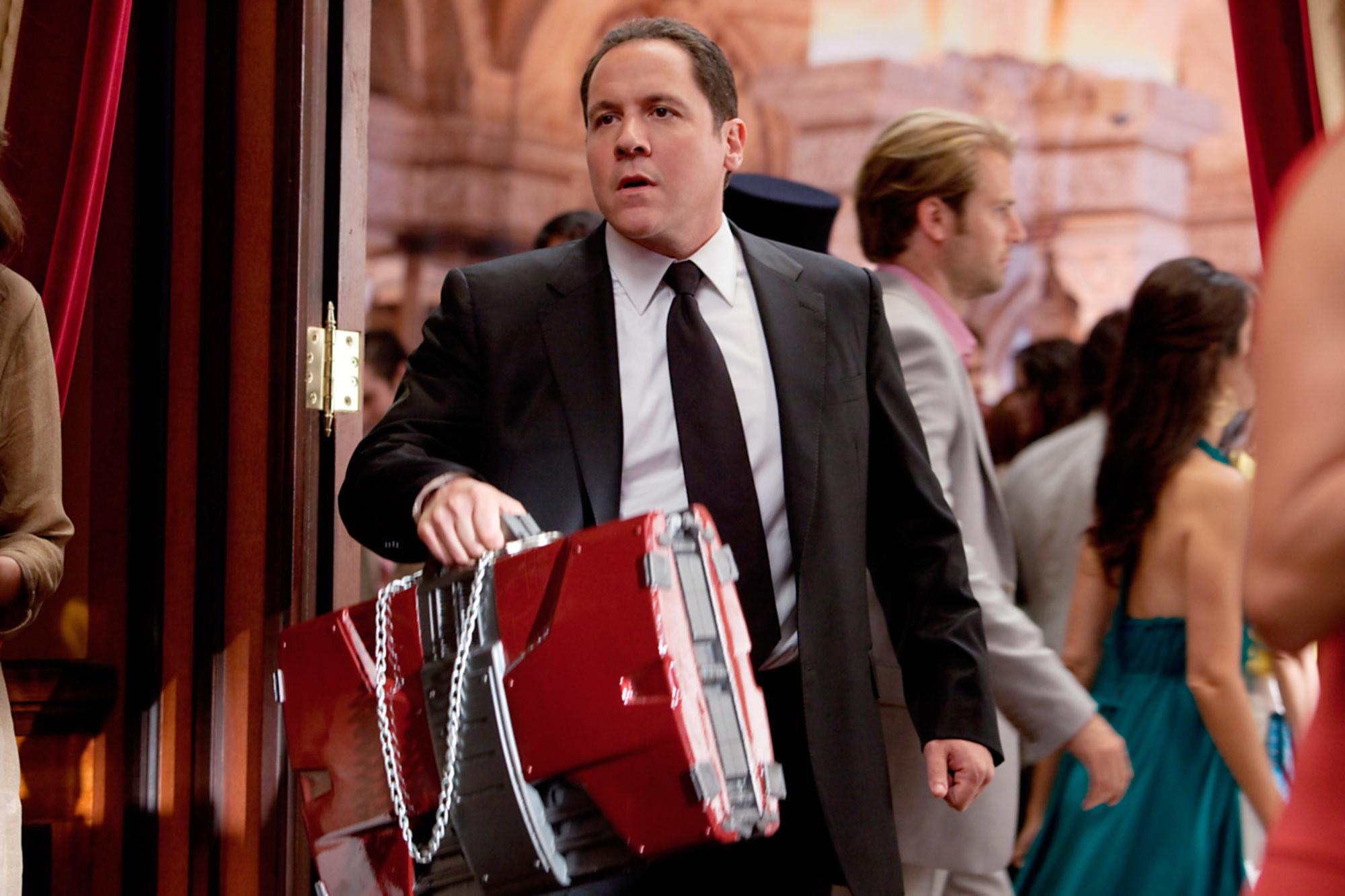 Happy Hogan holding the Iron Man suitcase