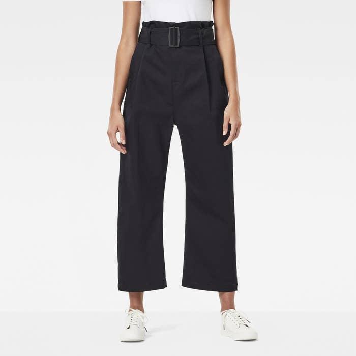 A model wears the pants in dark denim