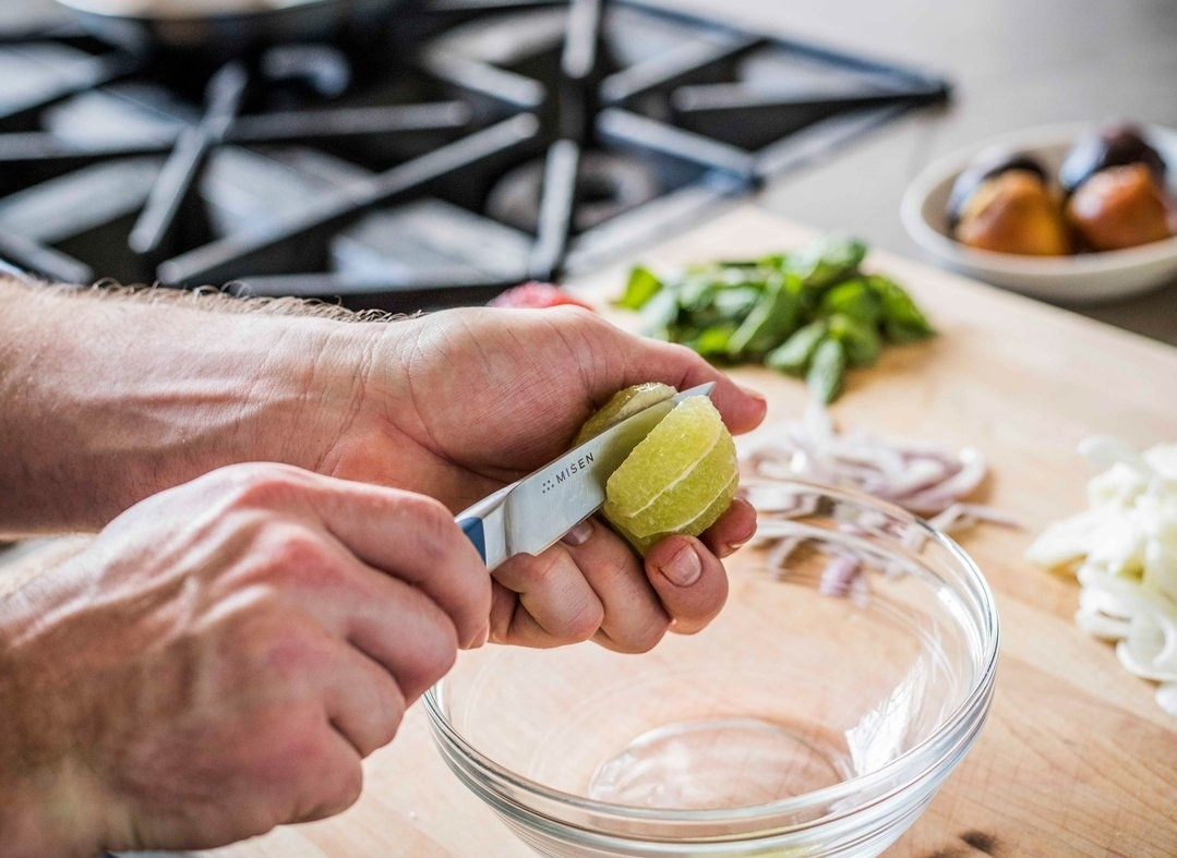 paring knife cutting a peeled lime