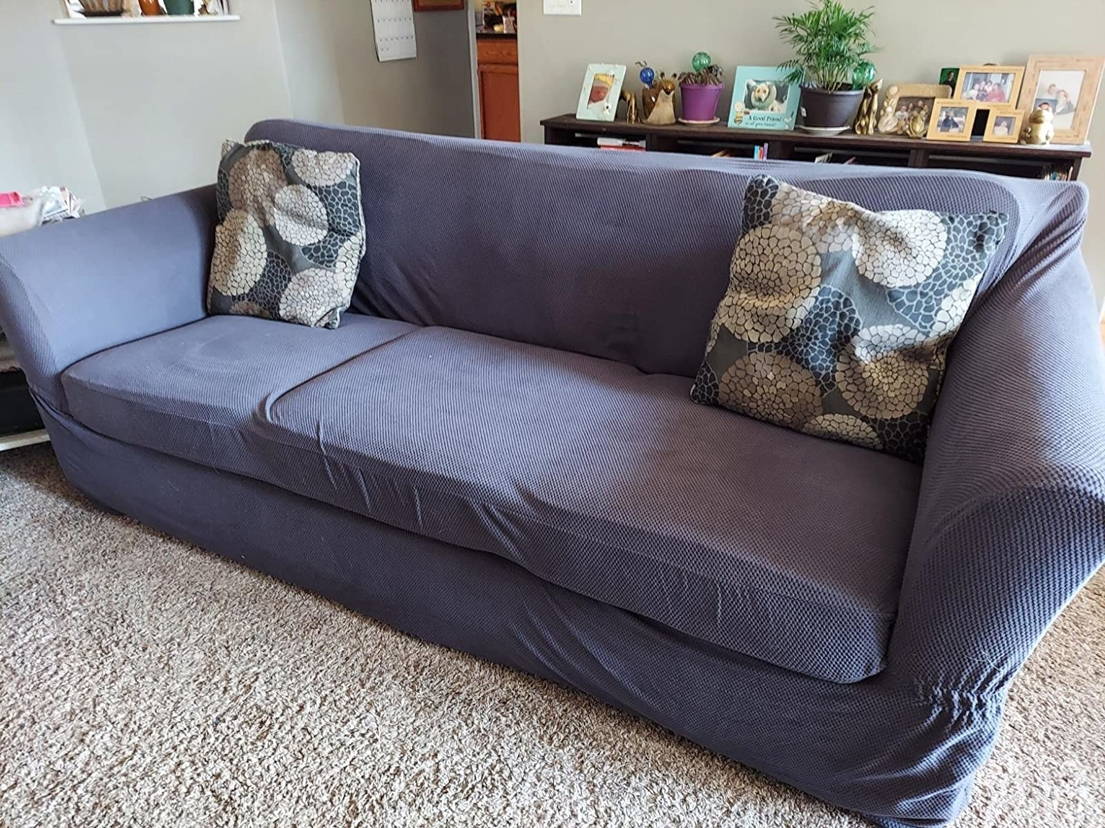 reviewer photo of the blue couch cover