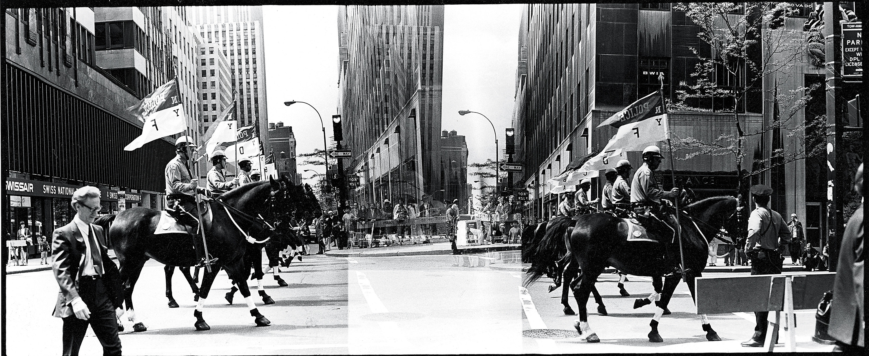 Mounted police walking down a street in New York