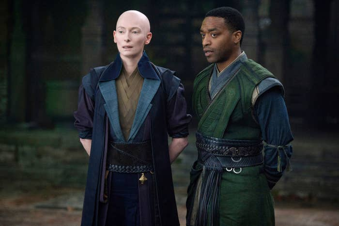 Tilda andChiwetel Ejiofor stand with their hands clasped behind them