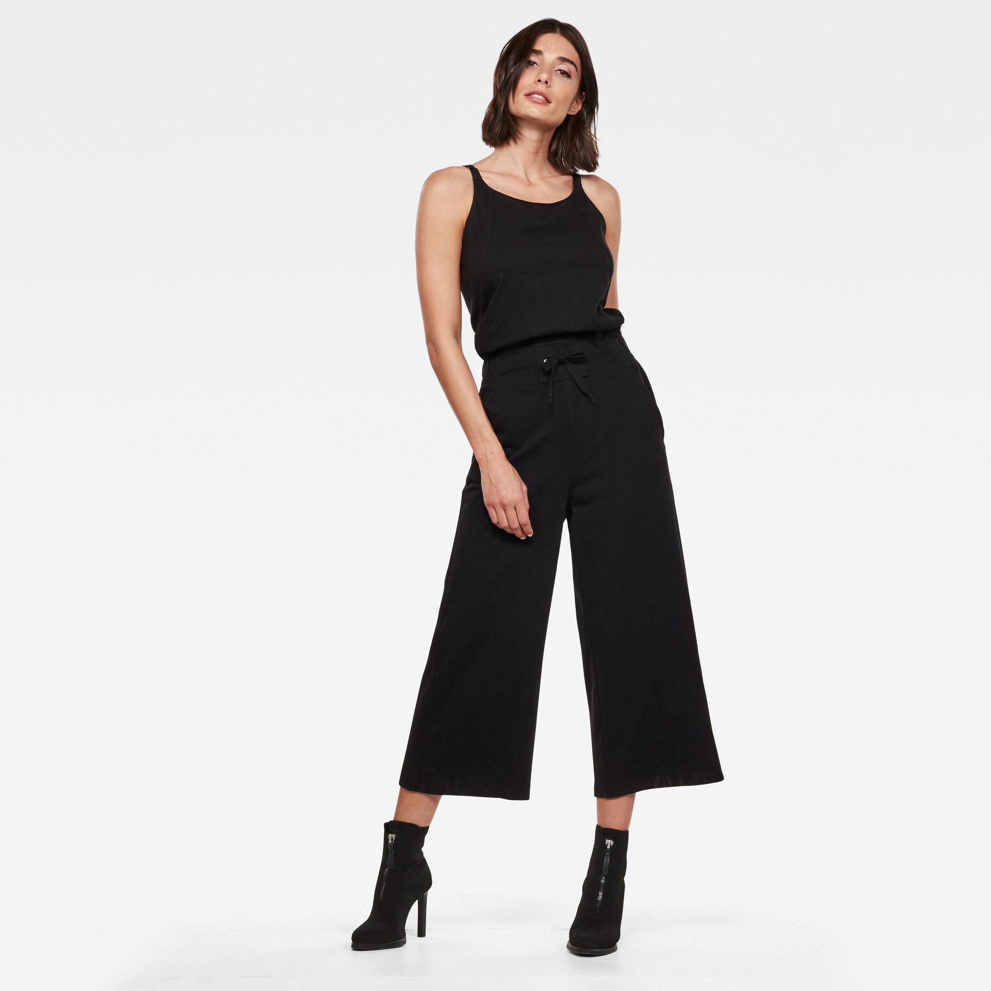 A model wears the black jumpsuit