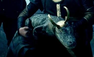 a crocodile with a loki hat on its head