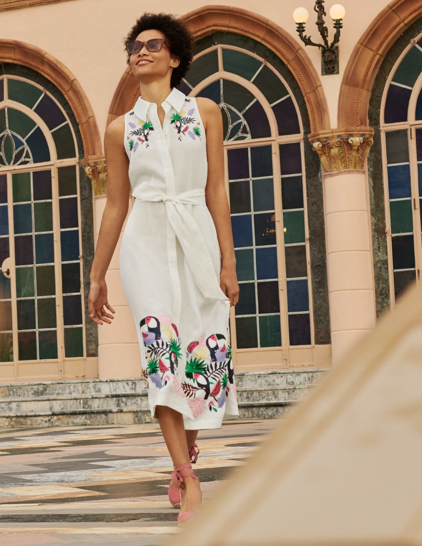 white collared shirt with tropical pattern on bottom of skirt and on the shoulders