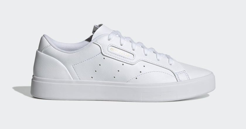 crisp white sneakers with white laces and hole designs on the side