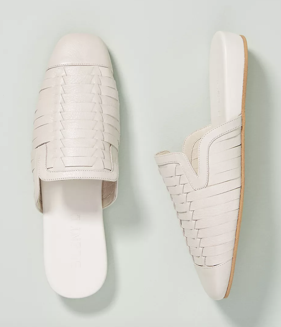 A pair of white woven close toed sandals