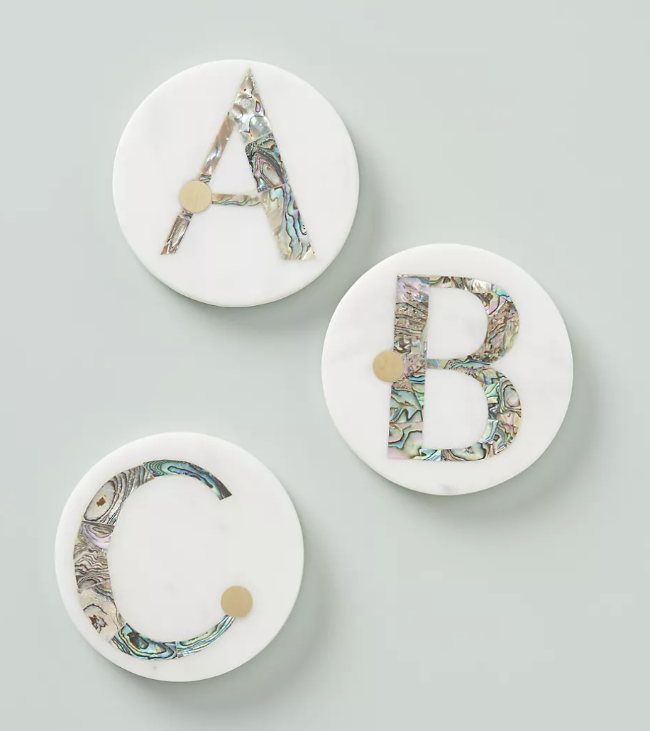White coasters with granite designed monogram letters in them