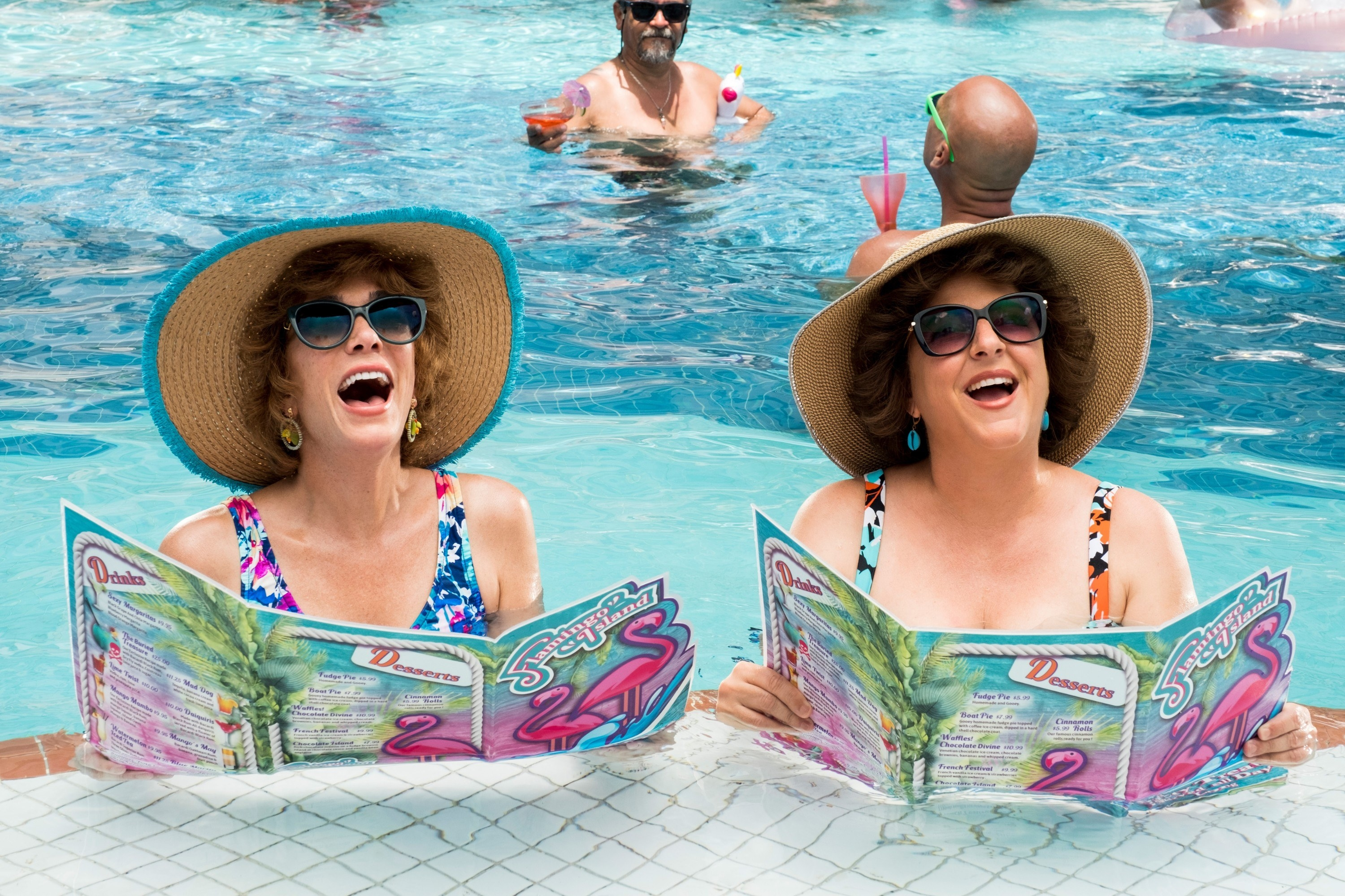 Kristen Wiig and Annie Mumolo hanging out in the pool