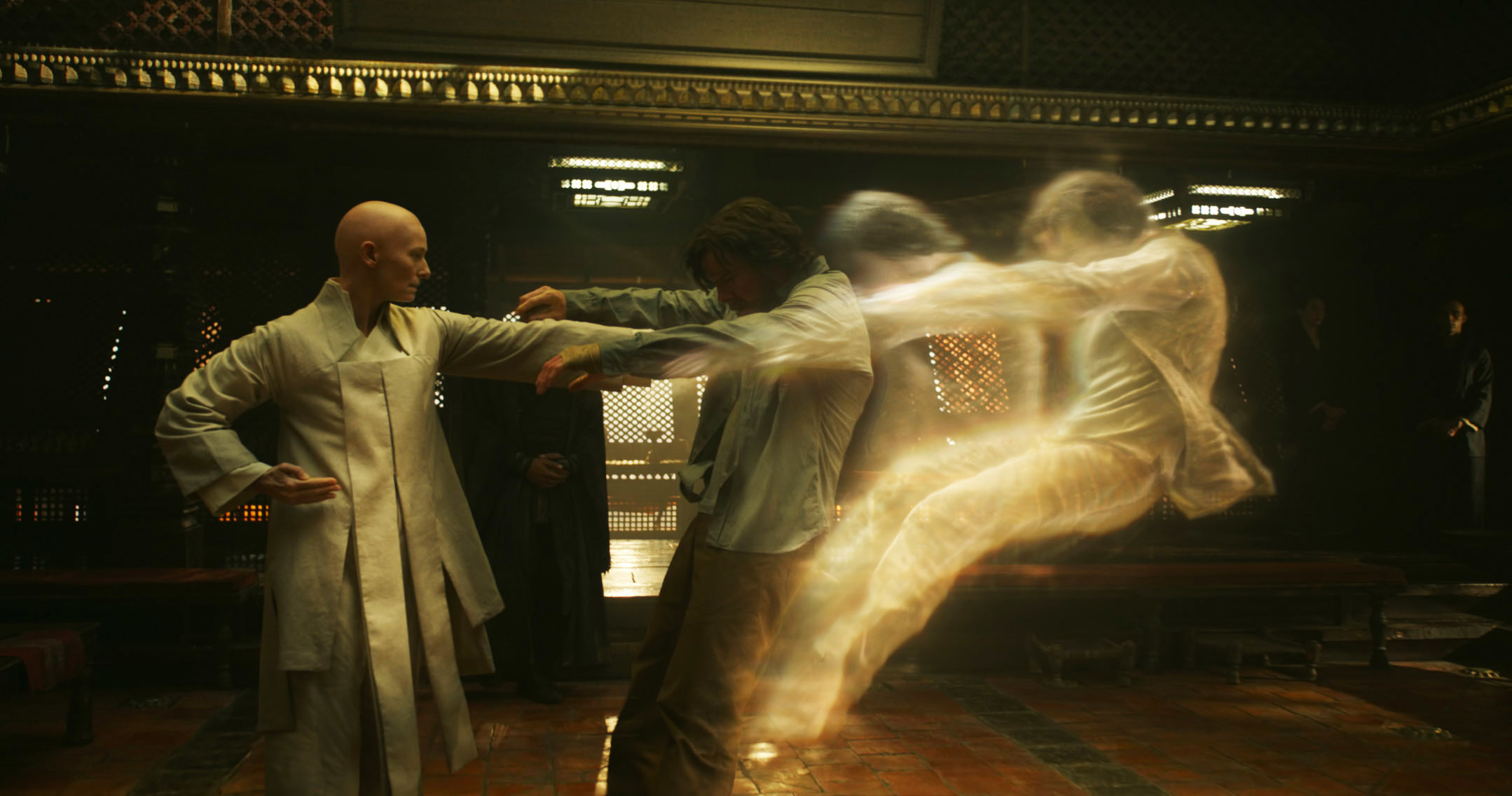 The Ancient One pushing Dr. Strange's astral form out of his physical form