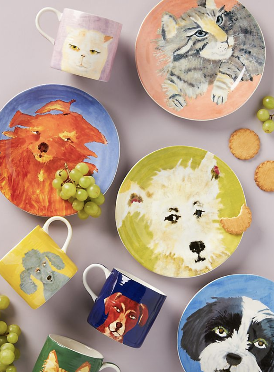 Dessert plates with water color dogs and cats on them