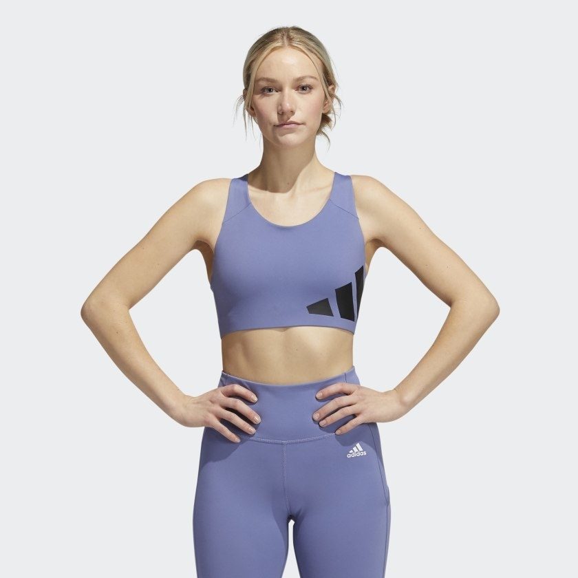 model wearing lilac high intensity sports bra with three strips on the side