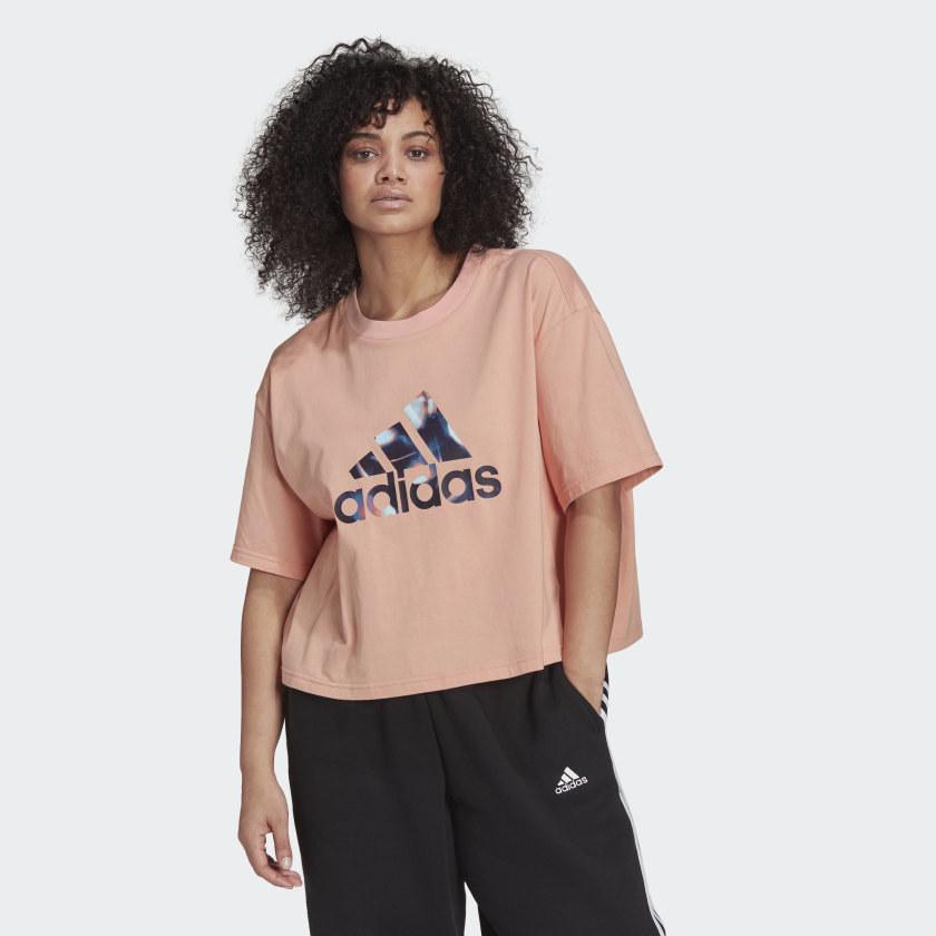 model wearing a pink white adidas logo t shirt