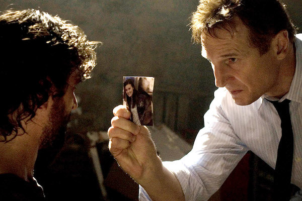 Liam Neeson holding a photo of his daughter
