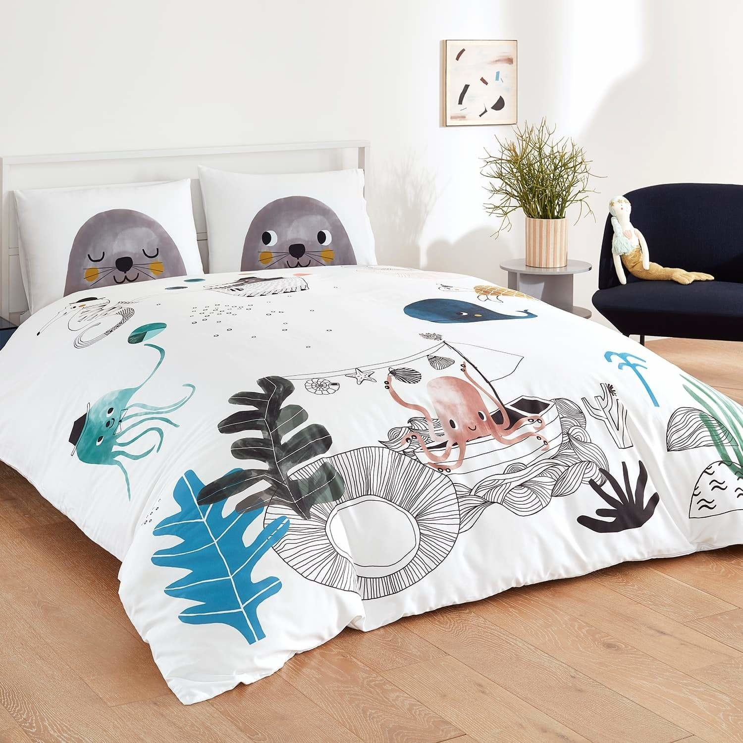 the underwater love bedding set on a bed
