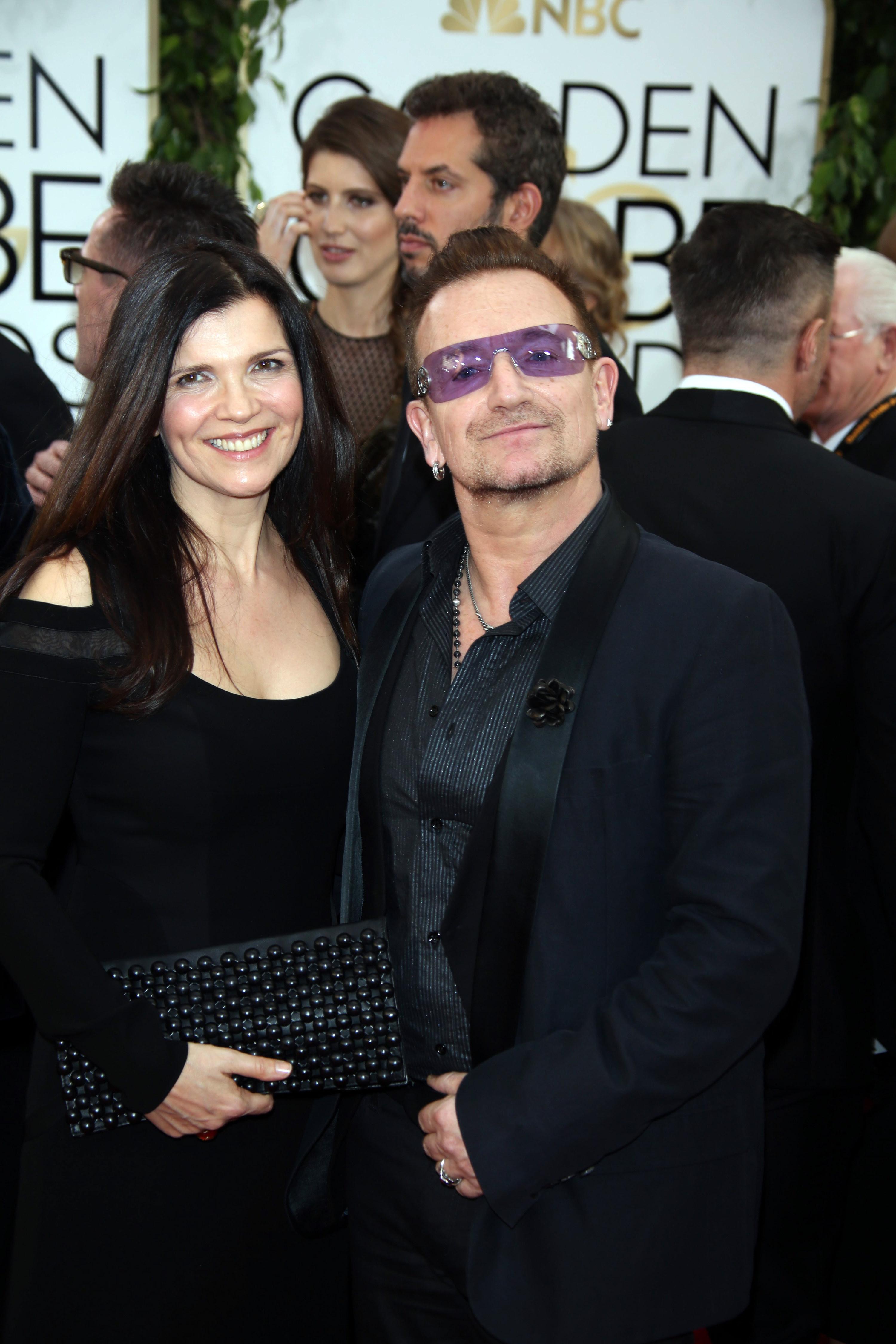 he has purple sunglasses she is wondering why