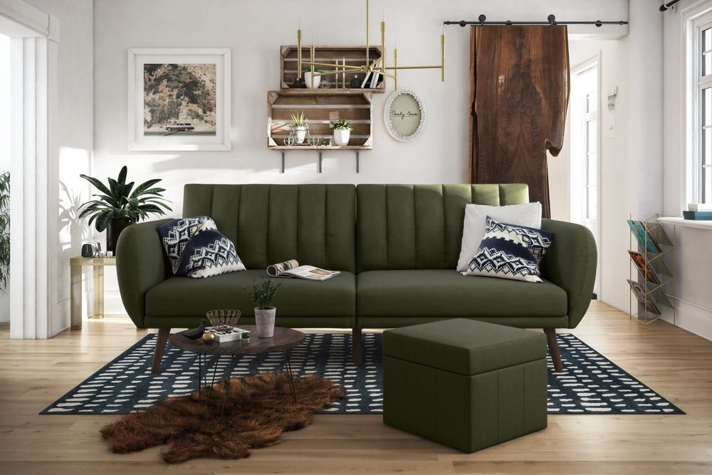 the dark green brittany futon and ottoman in a decorated living room