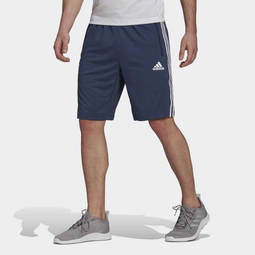 model wearing blue workout shorts