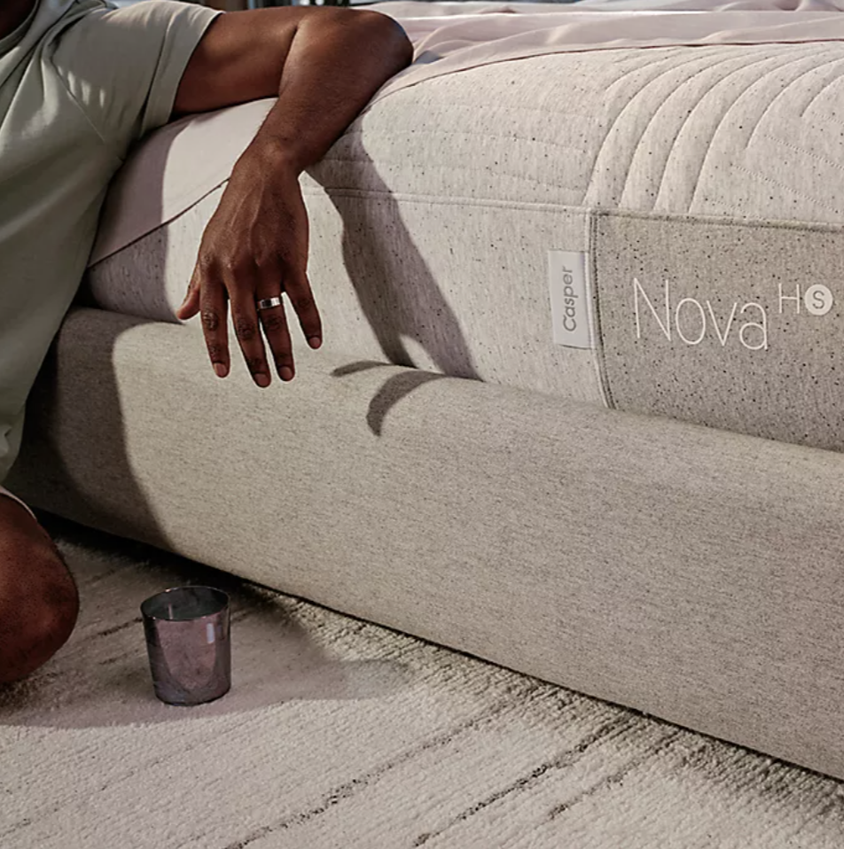 A person leaning on the mattress