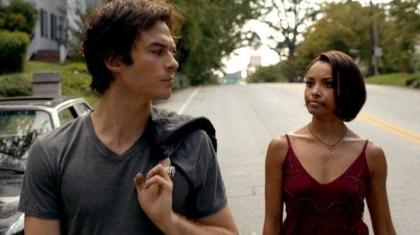 damon and bonnie walk down the street during the daytime