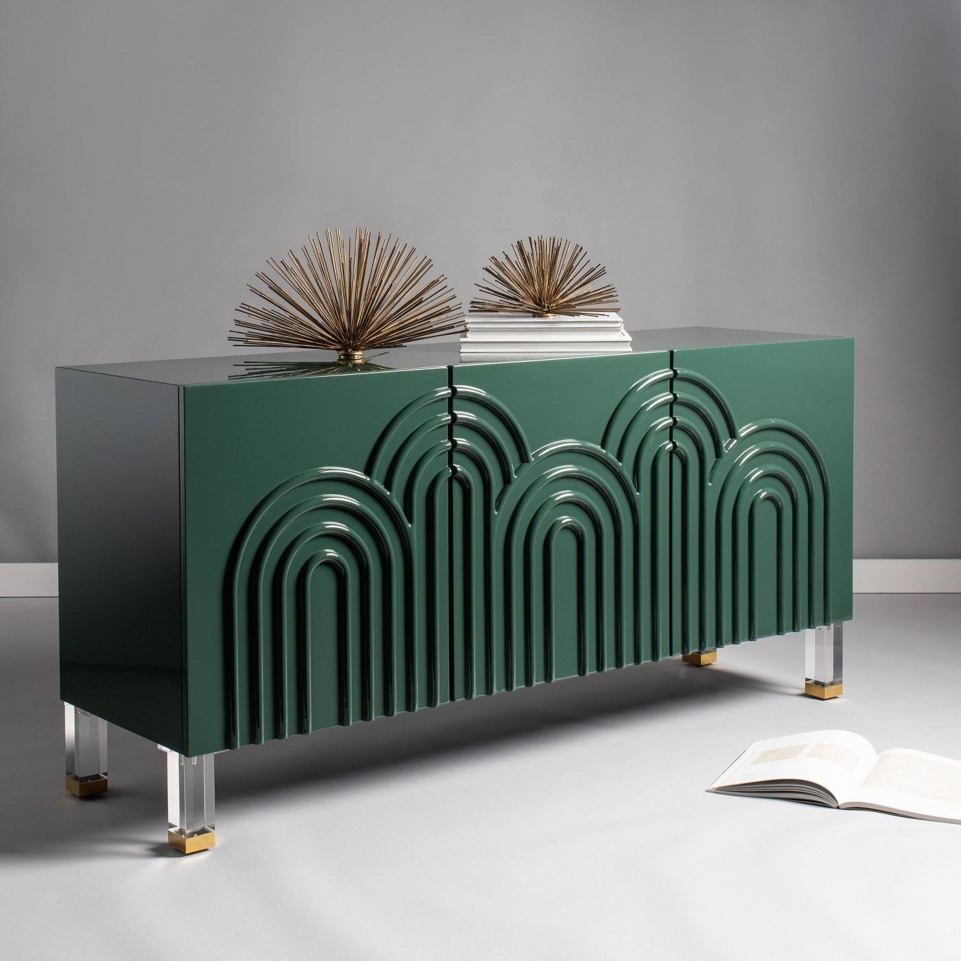 an emerald green sideboard table with clear legs