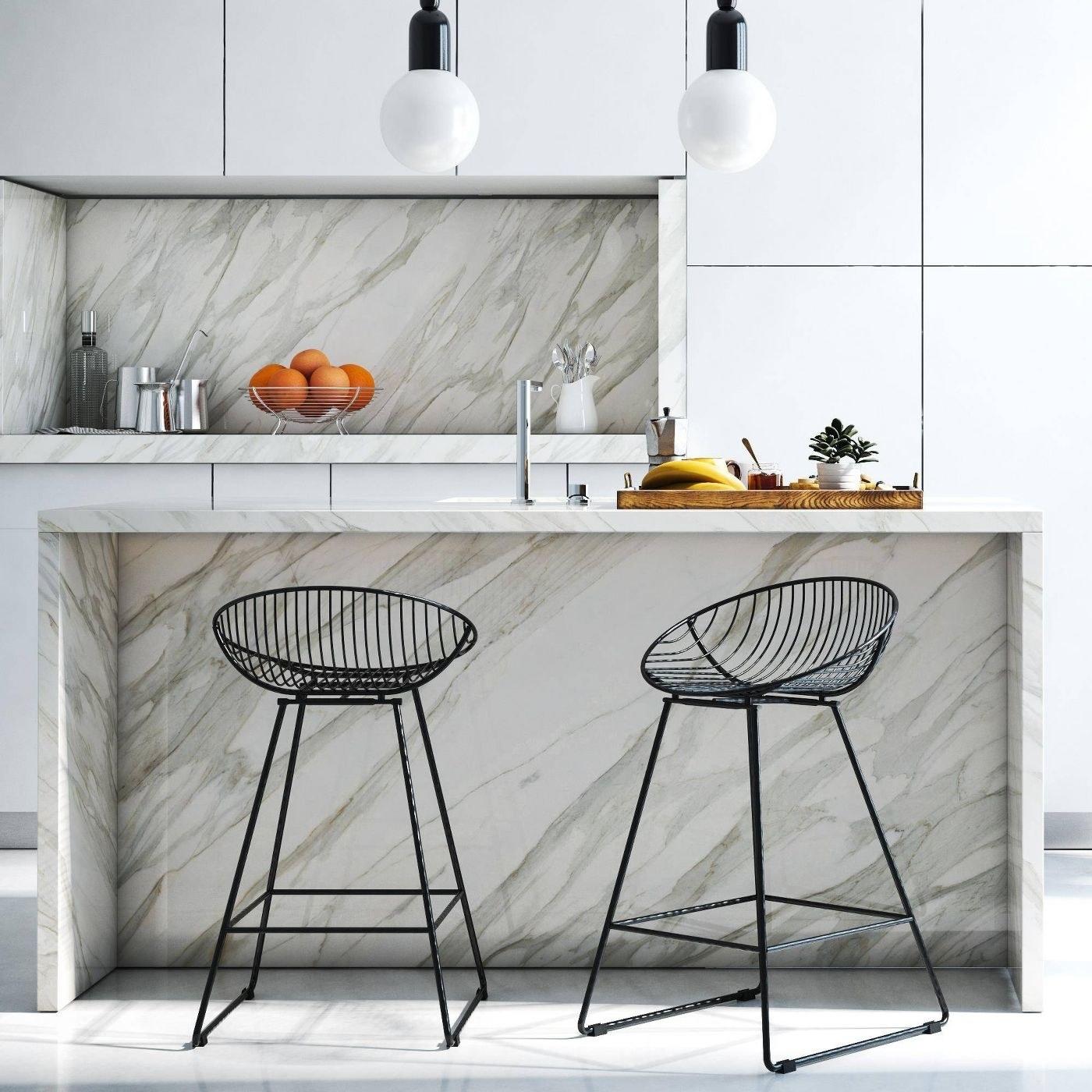 black wire bar stools at a kitchen island