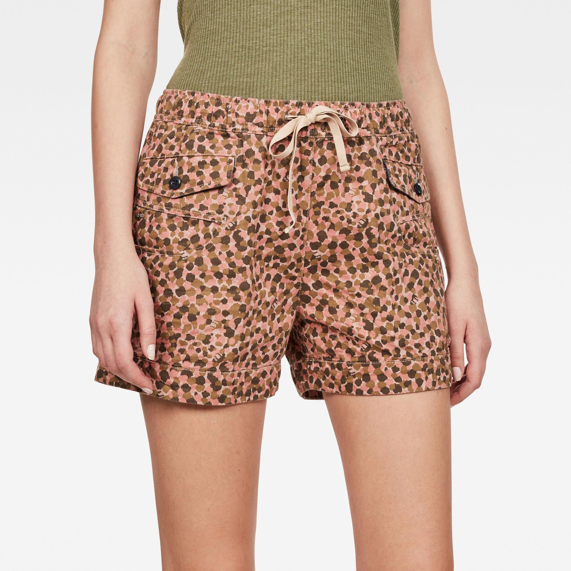 A model wears the dot-patterned shorts