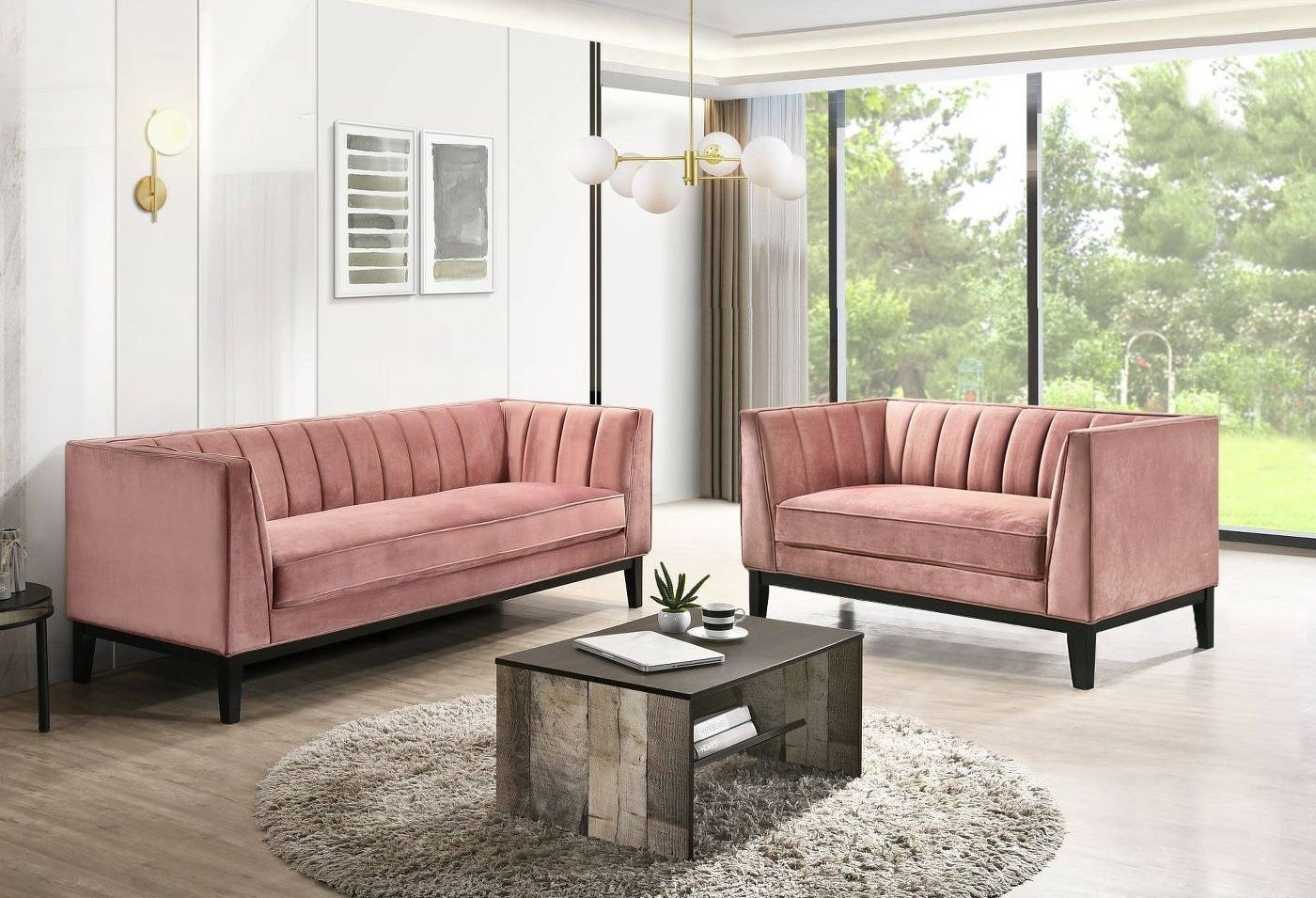 two pink velvet couches in a living room