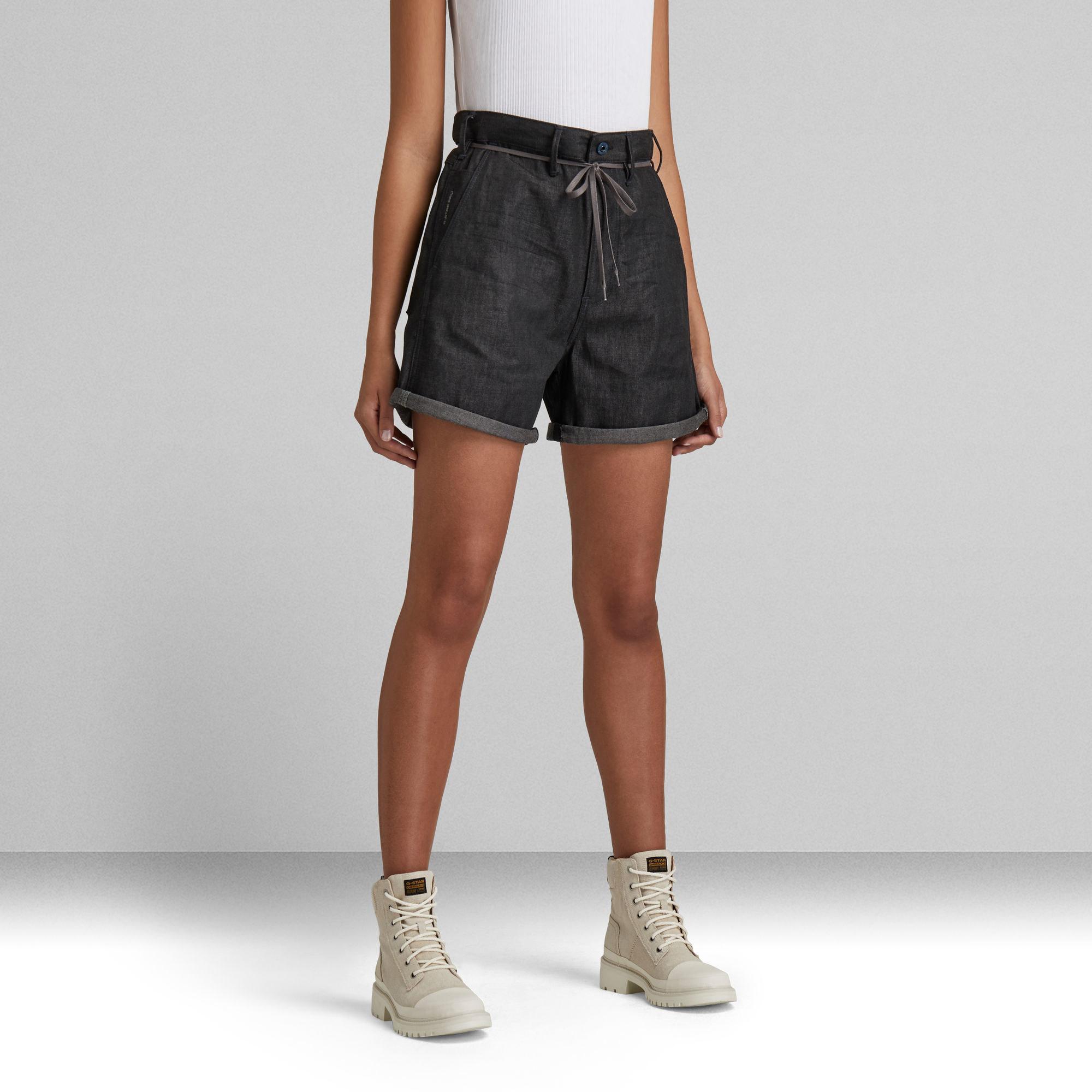 A model wears the shorts in dark indigo
