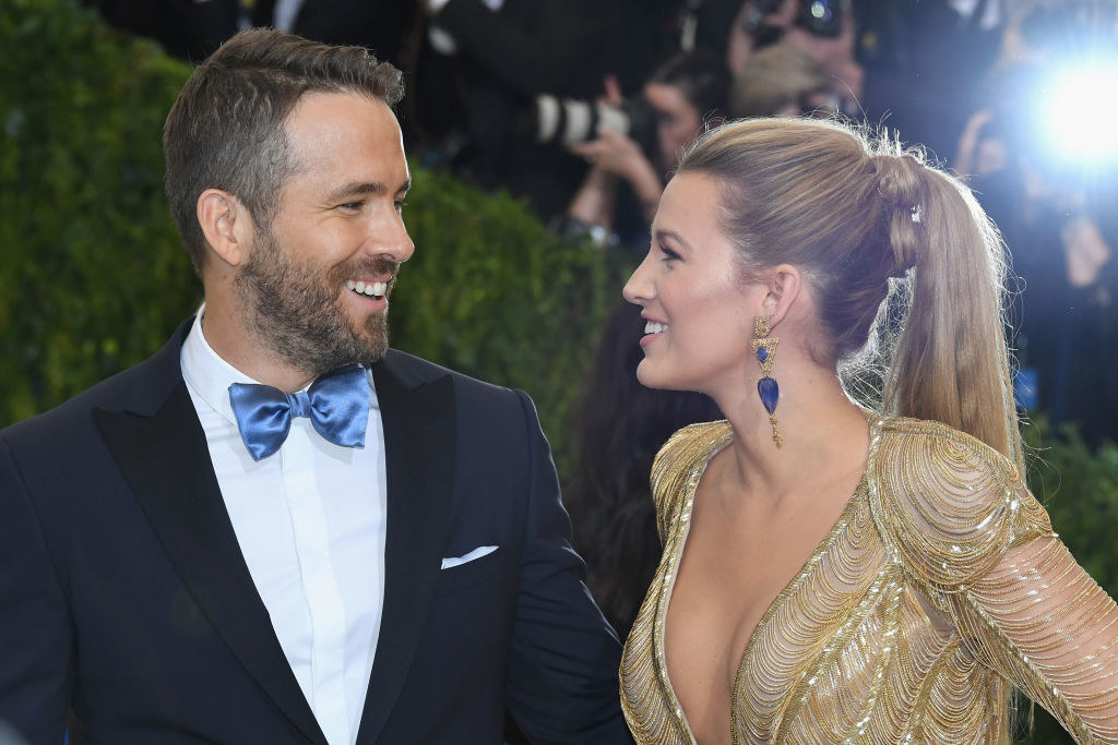 """Ryan Reynolds (L) and Blake Lively smiling at each other as they attend the """"Rei Kawakubo/Comme des Garcons: Art Of The In-Between"""" Costume Institute Gala"""