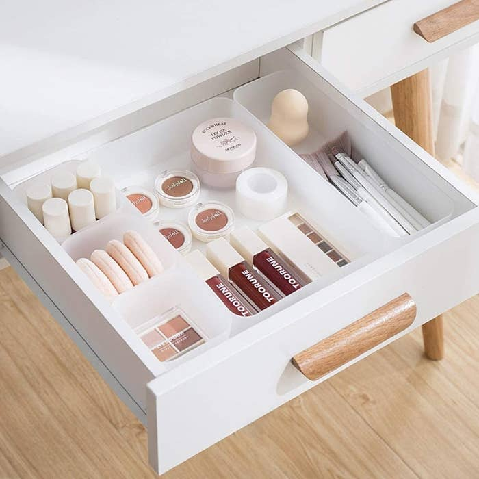 the five compartment drawer organizer containing makeup products