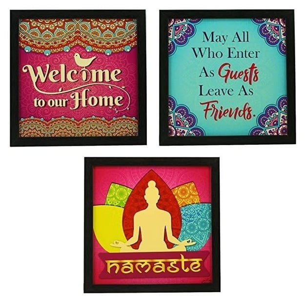 """Black frames with colourful posters that have different quotes on them, """"Welcome to our home"""" or """"May all who enter as guests leave as friends"""" and """"Namaste"""""""