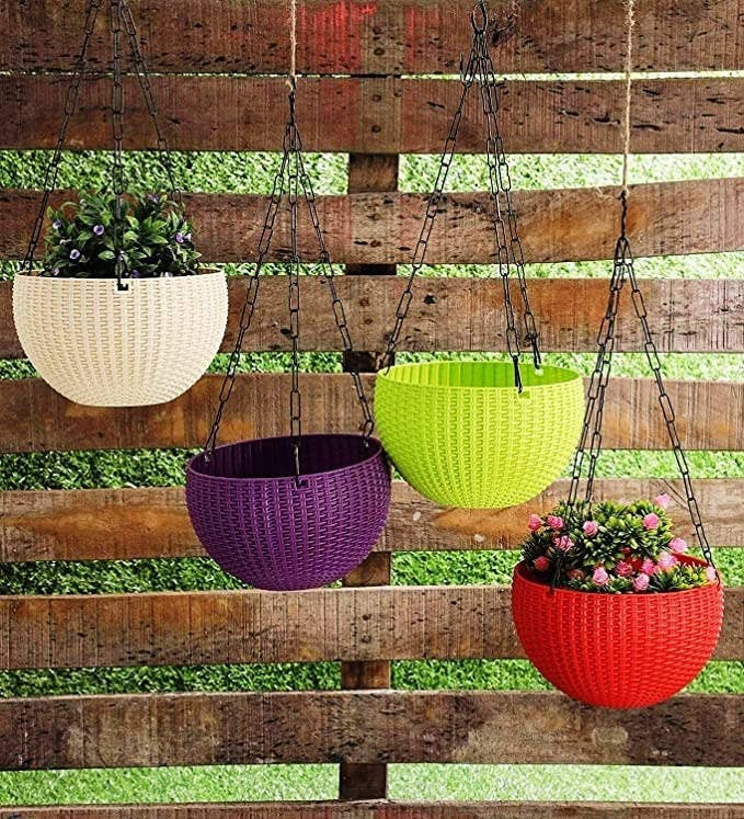 White, purple, red and green hanging pots