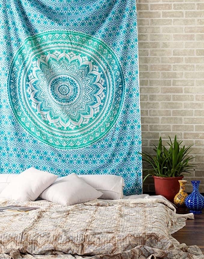 Blue bohemian wall tapestry with a mandala print