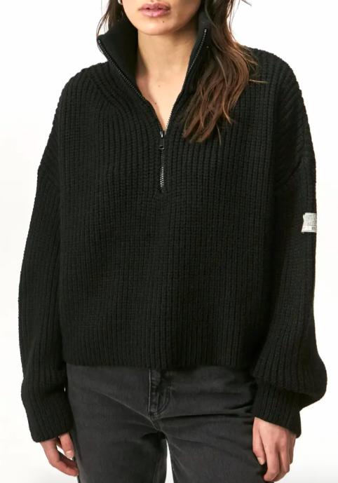 A model wearing the sweater in black
