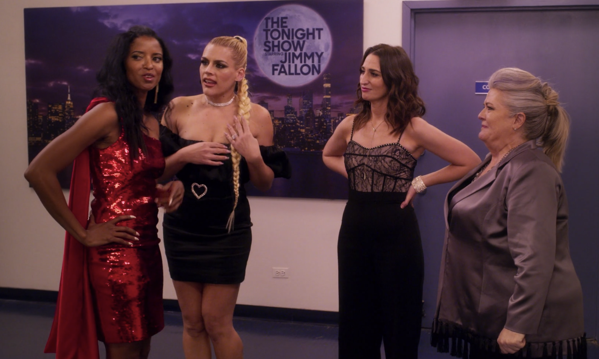 """Renée Elise Goldsberry, Busy Philipps, Sara Bareilles, and Paula Pell having a conversation at """"The Tonight Show"""" as Wickie, Summer, Dawn and Gloria in """"Girls5eva"""""""