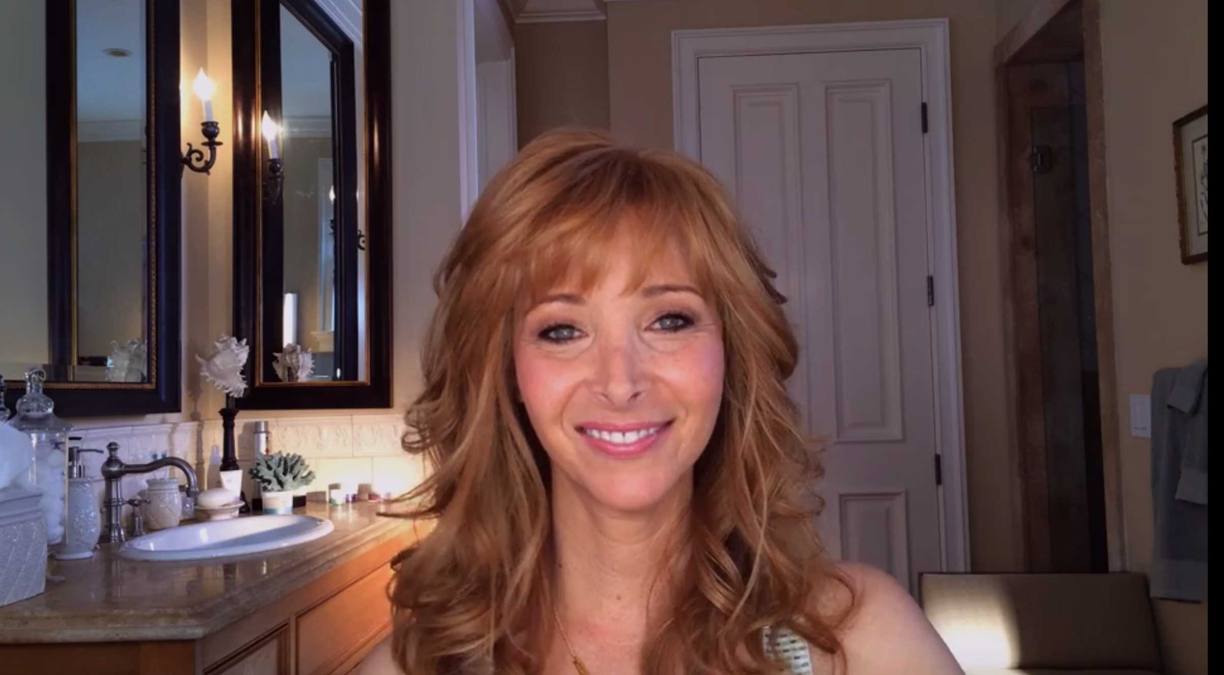 """Lisa Kudrow smiles at the camera as Valerie in """"The Comeback"""""""