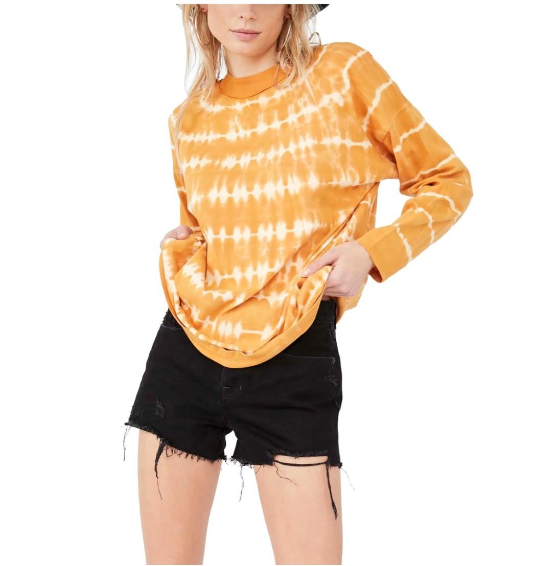 the tie-dye long sleeve t-shirt in orange neutral combo on a model