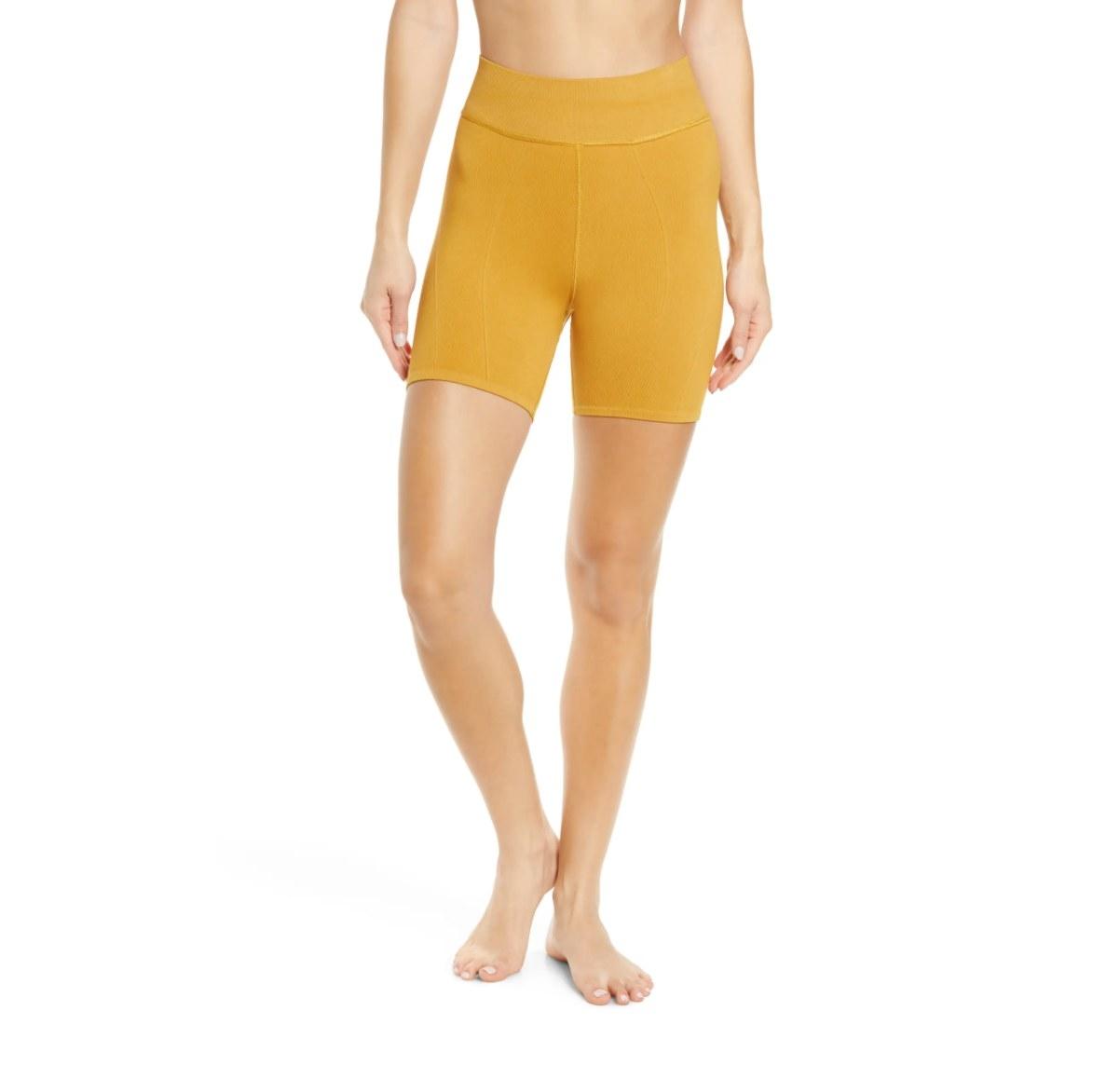 the pair of seamless bike shorts in tumeric
